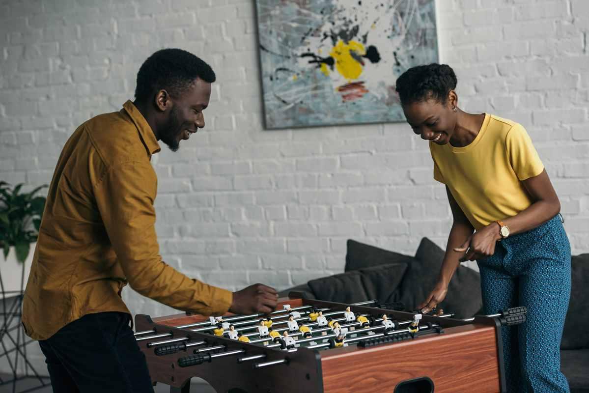 Black people playing foosball
