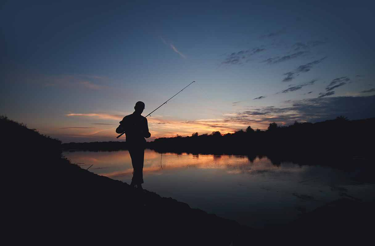 Fishing man sunset